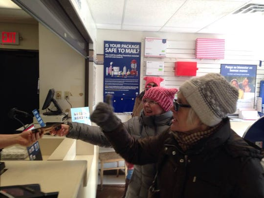 Members of Indivisible Northern Door County mail postcards to the White House Wednesday, March 15, 2017.