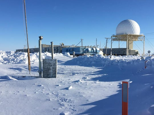 Photo of a sign post in Barrow, Alaska, shows distance to Paramus. Photo taken by T. Sean Herbert.