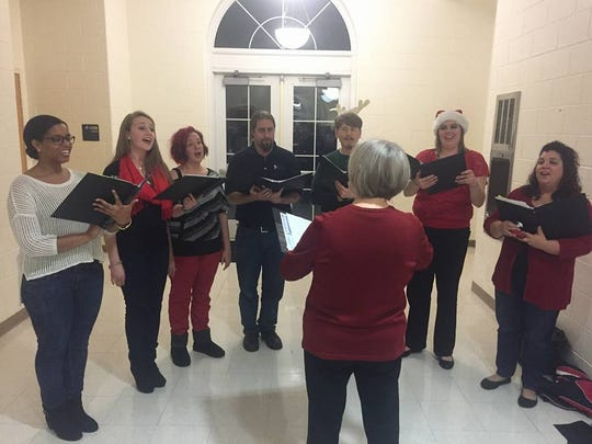 Artistic director and conductor Deb Vanneman directs some of the members of the Rancocas Valley Singers group, an adult ensemble, made up of many former RV students. The group has expanded to include members from other Burlington County and Camden County towns as well. Vanneman, a choir director at RV for 27 years before she retired, helped found the group.