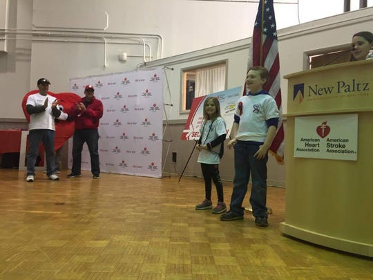 Madison Dallies, 8, and Matthew Burchell, 9, are honored at the Ulster Heart Walk. Both were born with heart defects.