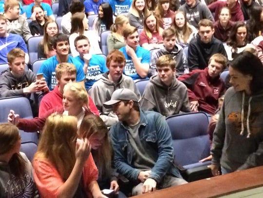Iowa native and celebrity Ashton Kutcher meets with