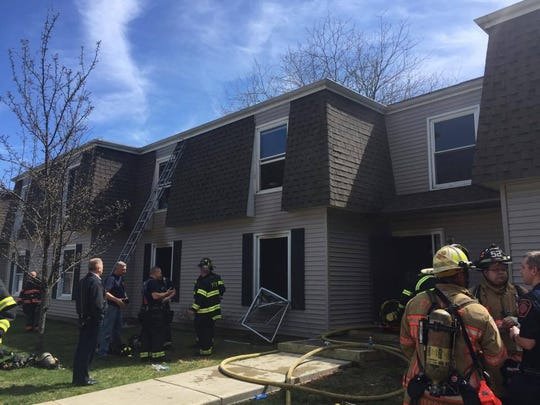 Emergency personnel stand outside Building 21 at around 2 p.m. Sunday. The fire was extinguished and under control by around 2:33 p.m.