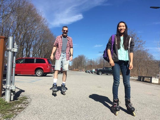 Matt Stanton, 49, and his daughter, Sophie Stanton, 14, head toward the start of the Walkway Over the Hudson. They planned to take the route that goes from the walkway to the Mid Hudson Bridge.