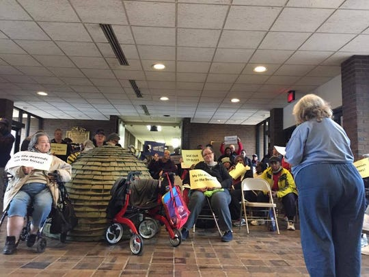 Helen Clawson, 73, of the City of Poughkeepsie, addresses supporters Wednesday. She said she rides both the county and city buses and prefers the city services.