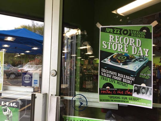 A sign advertising Darkside Records' National Record Store Day celebration hangs on its front door. It's their biggest business day of the year, according to management.