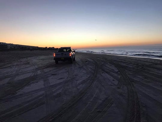 After a day of severe weather hampered the search for a swimmer missing for two days on St. George Island, rescue officials searched the entire length of the barrier island without results Tuesday.