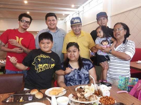 The Ricafrente family shares a family meal together.