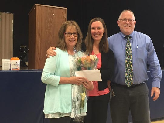 Teacher of the Year Lois Parker (left), Midland School Principal Kristen Zizelmann (center) and Midland President and CEO Shawn McInerney.