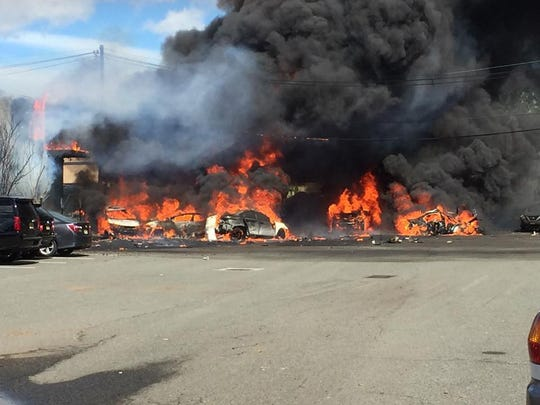 Multiple buildings were on fire after a plane crashed in Carlstadt on Monday.