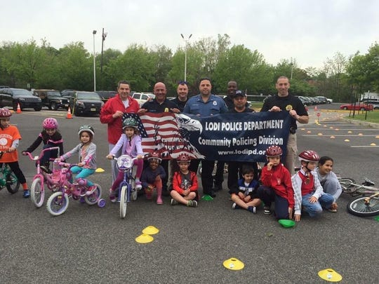 Group photo from last year's event of police officers with young bikers. Officers pictured from left to right: Chief Vincent Quatrone, Traffic Sergeant Russell Inserra, Operations Sergeant Michael Paglia, Police Officer Philip Nobile, Traffic Officer Andelson Mindest, Detective Legrand Castro, and Community Policing Sergeant Anthony Mobilio.