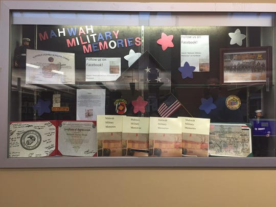 "The book ""Mahwah Military Memories,"" which examines the lives and experiences of dozens of local veterans, on display at the Mahwah library."