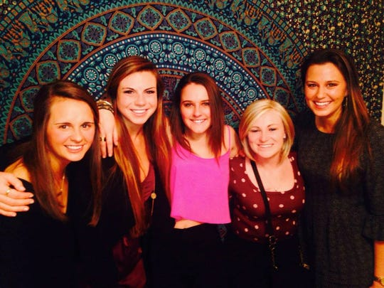 Kate (far right), Colie and their roommates celebrate