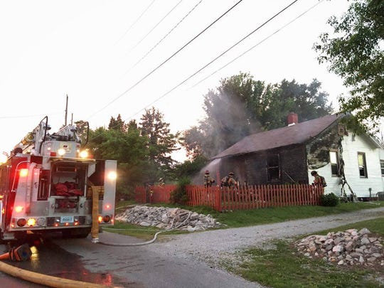 Firefighters work a house fire at 301 Ingle Avenue Thursday night.