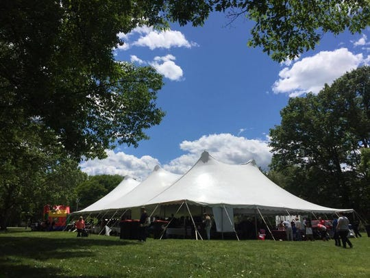 Restaurants and patrons fill the tent housing A Taste