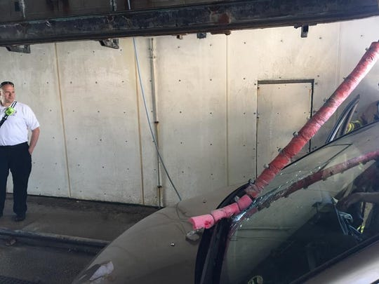 A pole inside a car wash shattered the windshield of