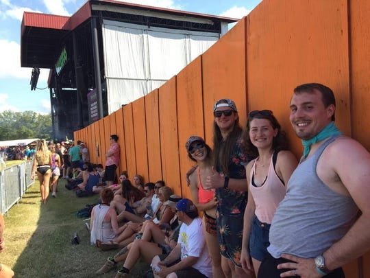 Chloe McCaffey (left) and Collin Comeaux wait with brand new line friends Eric and Brittney Merle, to get in the pit at Red Hot Chili Peppers. The group waited more than 11 hours for the show.