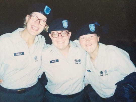 Erin Mills, center, served in the Army and later volunteered