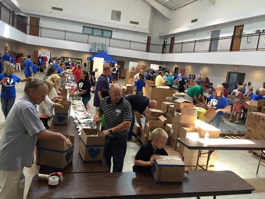 Members of Zion Lutheran Church and other volunteers pack food boxes for Children's Hunger Fund in 2016. The church will sponsor the same event Aug. 27. Commitments are sought to help pay for the boxes, which will be distributed to families in Abilene and in Texas. Deadline for commitments is June 30.