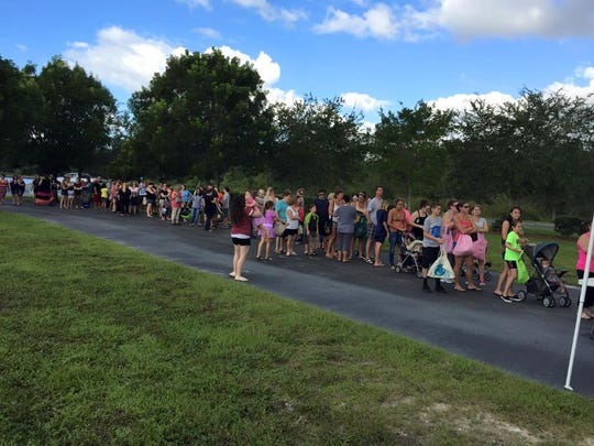 Needy mom's wait in line for food donations