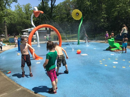 Children enjoy the spray park during the reopening