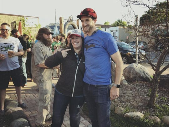 TickPick co-CEO and co-founder Brett Goldberg, right, poses with Upper Peninsula resident Amber Johnston on June 21, 2017 at Blackrocks Brewery in Marquette.