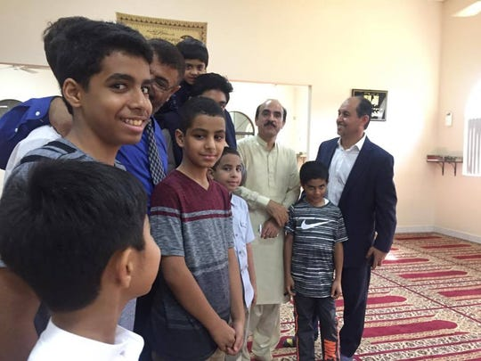 Children gather inside the Islamic Society of Brevard mosque shortly after special Eid - or holy day - services.