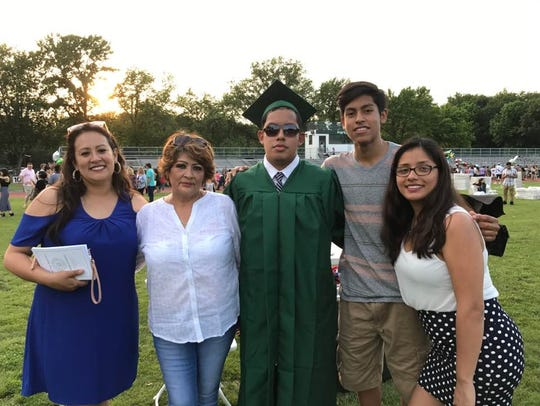 Steven Arias of Totowa, center, with his family. He