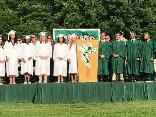 Students in the chorus sing during the graduation ceremony