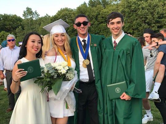 Kristine Feng, Jennifer Sabbak, Michael Festa and Jack Gianduso, from left show their diplomas June 22 at Passaic Valley High School's graduation.