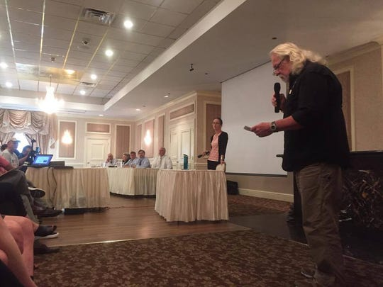 Gil Hawkins, 72, asks a question for the EPA. He advocated