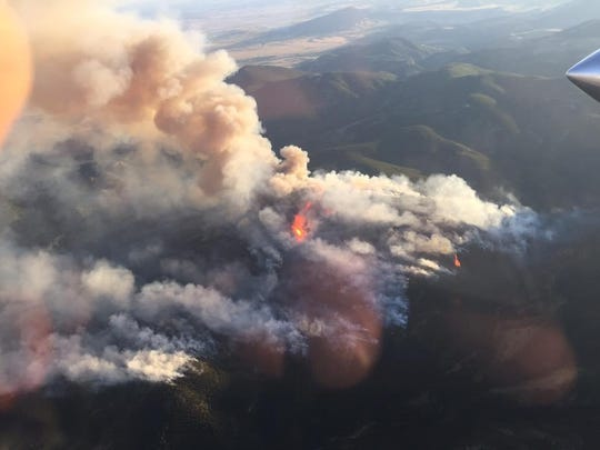A fire has burned hundreds of acres of timberland near Zortman in the Little Rocky Mountains.