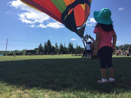 Saphia Muthukrishnan looks up toward the inflated hot-air