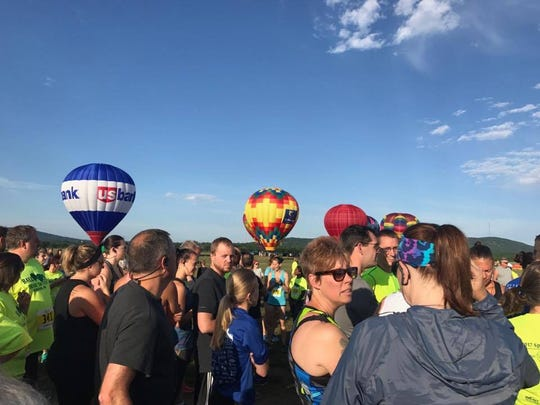 Runners await the launch of the 2017 Balloon Chase 5k Saturday morning.