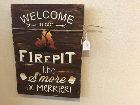 A hand-painted sign by the Wausau DIY Company.