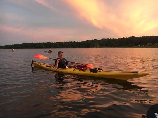 Paddling out to enjoy the full moon at Lake Jackson.