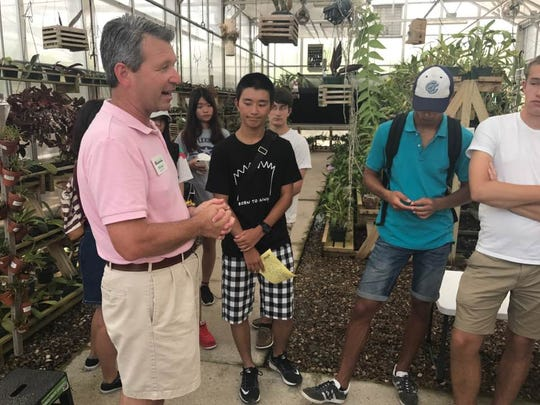 Michael Womack, executive director of the South Texas Botanical Gardens & Nature Center, gives the students a tour.