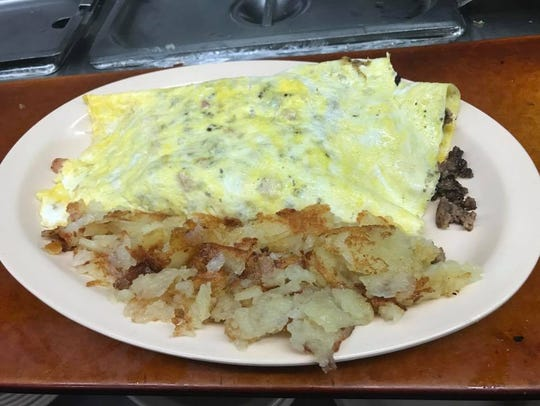 Hermitage Cafe's carnivore omelet and hash browns.