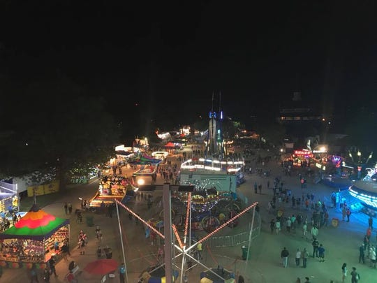 The view of the midway from the Ferris wheel isn't bad. We can see all the people leaving the grandstand from here!