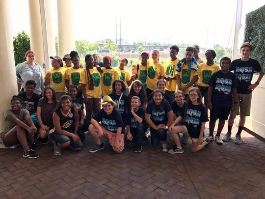 The San Angelo Aqua Squad poses with Project Flow members in Philadelphia during a tour.