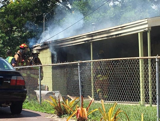 St. Lucie County firefighters battled a house fire