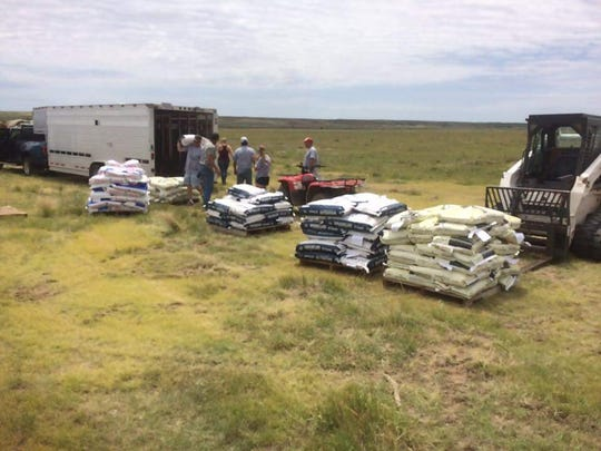 Ohio Relief Haulers volunteers work in Kansas in June. The group travels to farms and ranches hit hard by wildfires to help them rebuild.