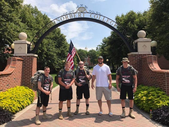 """Packers defensive end Dean Lowry (white shirt) met up with the """"For Them - 140 Mile Ruck"""" crew as they embarked on their 140-mile march from Ashwaubenon to Milwaukee."""