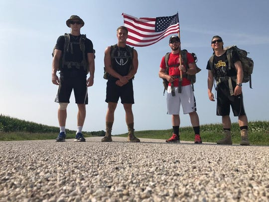 """""""For Them - 140 Mile Ruck"""" embarked on a 140-mile ruck march to raise money for the 4th H.O.O.A.H. Wisconsin, a volunteer nonprofit that supports American veterans."""