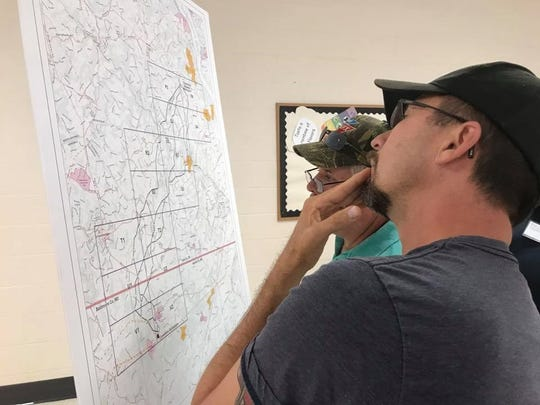 Landowners reviewed a preliminary map of a new above-ground power line Thursday, Aug. 10. Jana Benscoter/photo