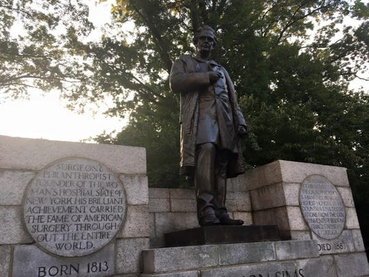 Protesters are demanding the removal of a statue in