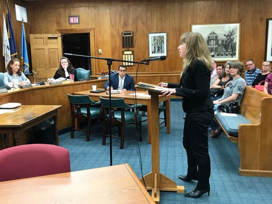 Millburn resident Sarit Catz demands that the Millburn Township Committee put a nonbinding referendum on the ballot in November that would seek to end the Complete Streets project.
