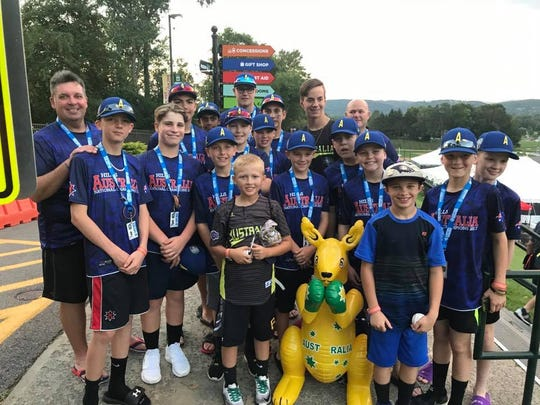 Luke Shoobridge and Keegan Hauke (next to the inflatable kangaroo) get their picture taken with members of the Little League World Series team from Australia.
