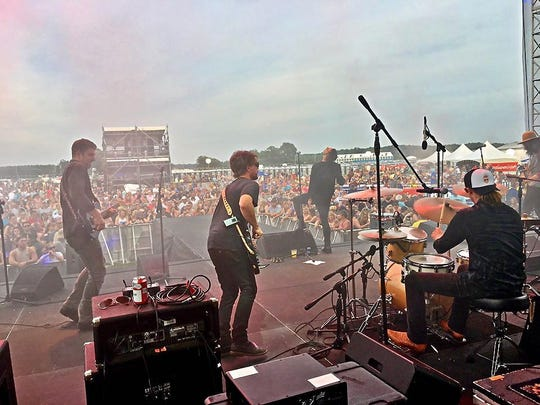 Cole Swindell and his band rock Hudson Fields near Milton earlier this summer.