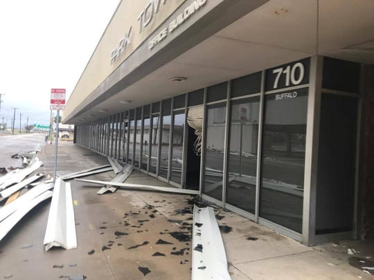 Hurricane Harvey debris from the uptown post office damaged the building across Buffalo Street.