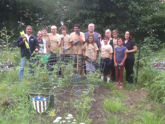 Members of Boy Scout Troop 139 joined Bergenfield Mayor Norman Schmelz and community gardener Mimi Parente to work in a garden and earn a merit badge. The troop also assisted senior citizen gardeners with the weeding of their plot of vegetables.